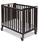Foundations Hideaway Compact Folding Crib Antique Cherry